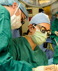 A general surgery resident assisting an Emory faculty surgeon in the OR.